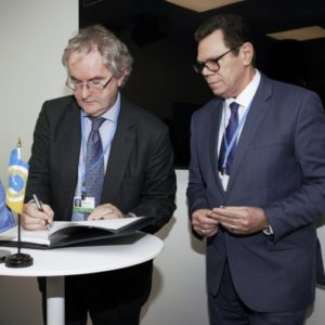 EIB Vice President responsible for Climate Action, Jonathan Taylor (left) and CDB President, Dr. Wm. Warren Smith (right) sign the agreement in Bonn on November 13, 2017.(Photo via CDB)